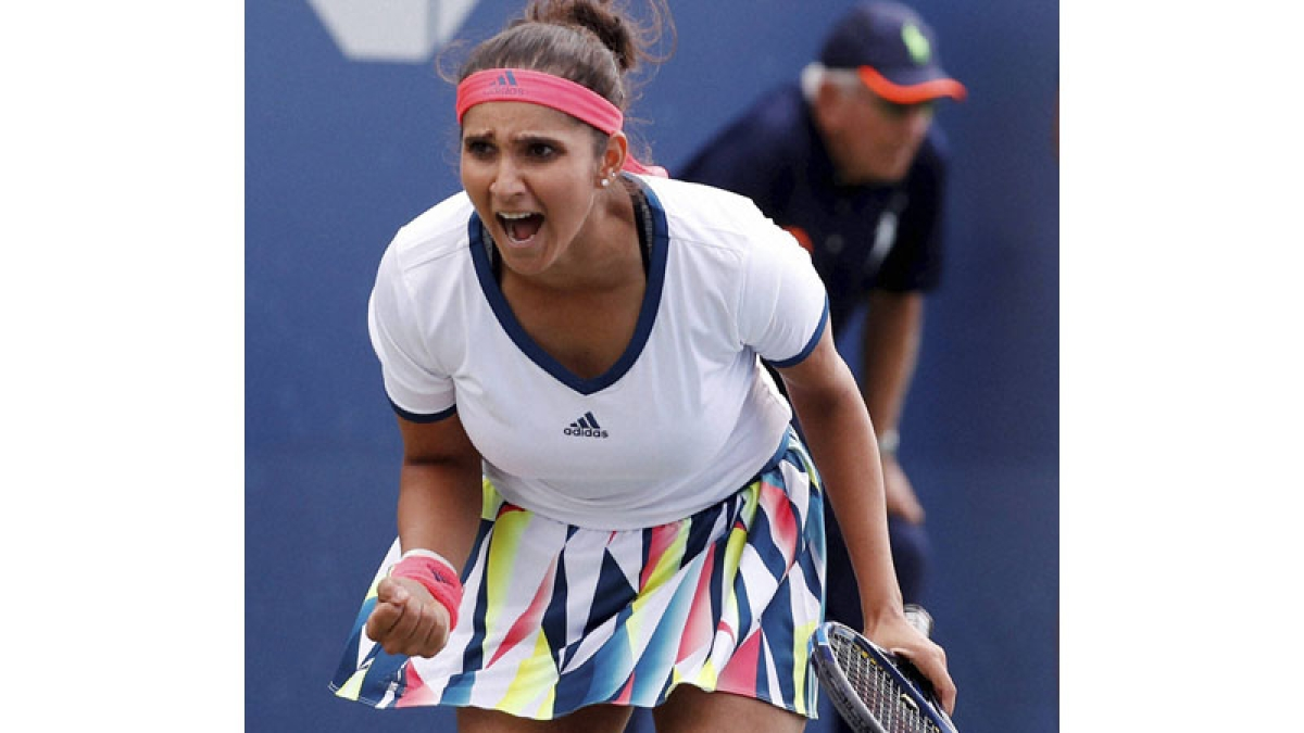 New York : Sania Mirza, of India, reacts after a shot against doubles opponents Viktorija Golubic and Nicole Melichar during the second round of the U.S. Open tennis tournament, Saturday, Sept. 3, 2016, in New York. AP/PTI(AP9_4_2016_000112B)