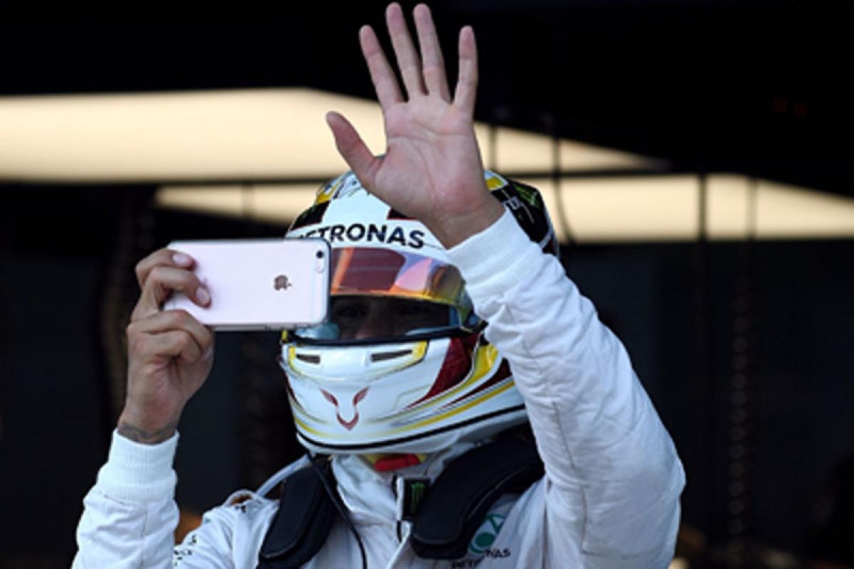 Rosberg fends off Hamilton