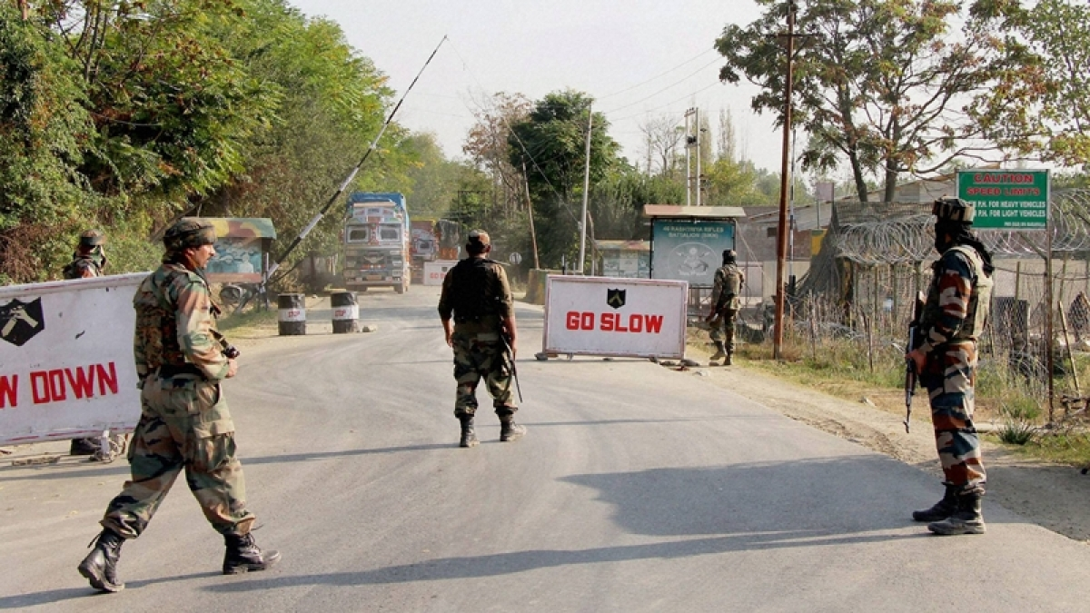 Baramulla: Soldiers guard at the Army base camp during a militants attack in Baramulla district of north Kashmir on Monday.
