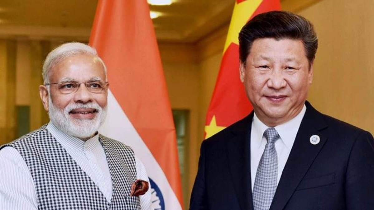 Tashkent : Prime Minister Narendra Modi with Chinese President Xi Jinping during a meeting in Tashkent on Thursday on the sidelines of SCO Summit. PTI Photo (PTI6_23_2016_000094B)