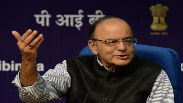 "Indian Finance Minister Arun Jaitley speaks during a press conference in New Delhi on November 9, 2016.  India's government tried to quell the panic November 8 caused by a bombshell decision to withdraw 500 and 1,000 rupee notes from circulation after cash machines ran dry and shares slid. A day after Prime Minister Narendra Modi announced the notes would no longer be legal tender in a blitz against ""black money"", his finance minister said replacement 500 and 2,000 rupee bills would be available from November 10 and only tax dodgers stood to lose out from the move. / AFP PHOTO / PRAKASH SINGH"