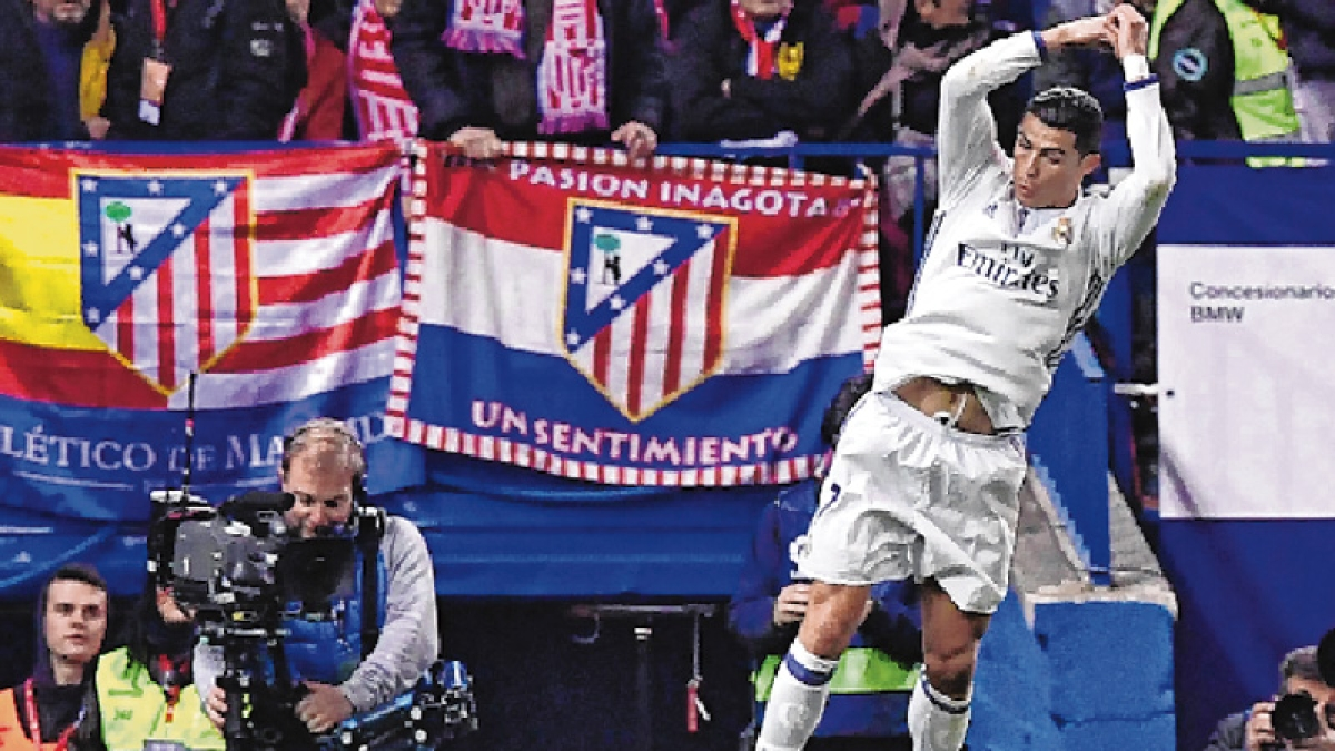 Ronaldo treble trouble Atletico : Real Madrid win derby 3-0 in La Liga