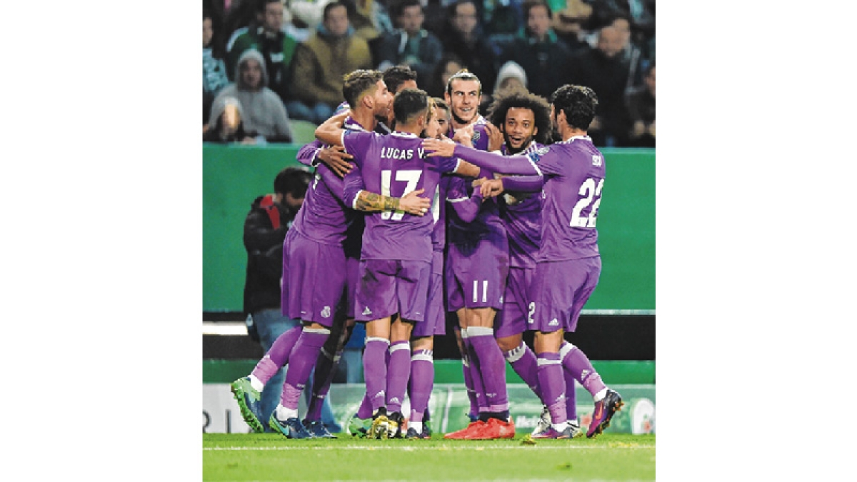 Real Madrid strom into last-16