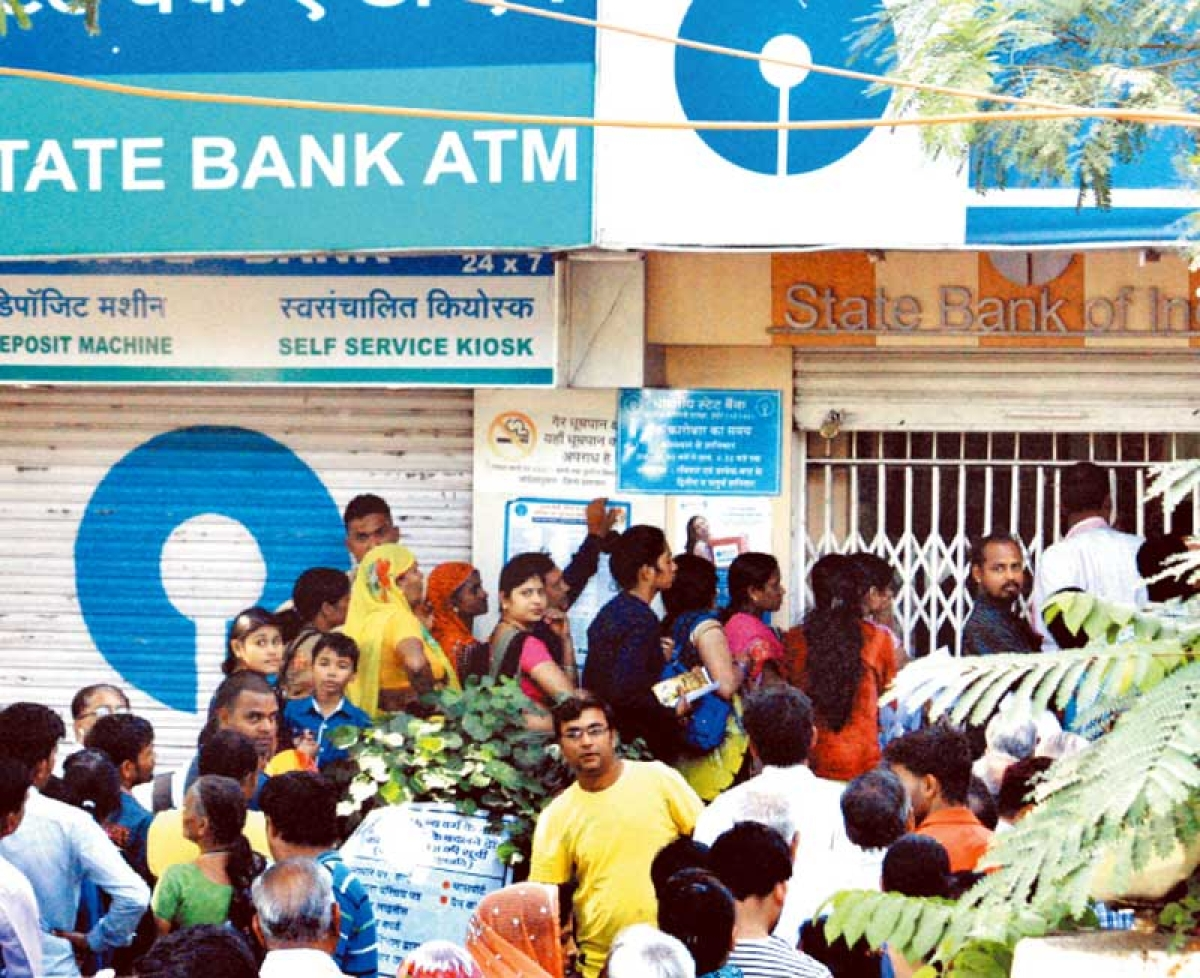 Long queues, no cash, trouble continues on day 2