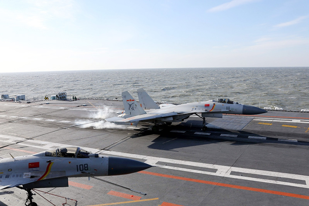 Beijing holds first live-fire drills with its aircraft carrier