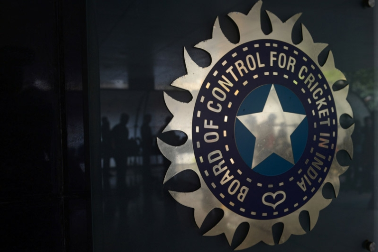 Journalists are reflected on a logo of the Board of Control for Cricket in India (BCCI) during the 87th BCCI annual general meeting in Mumbai on September 21, 2016. / AFP PHOTO / INDRANIL MUKHERJEE / ----IMAGE RESTRICTED TO EDITORIAL USE - STRICTLY NO COMMERCIAL USE----- / GETTYOUT