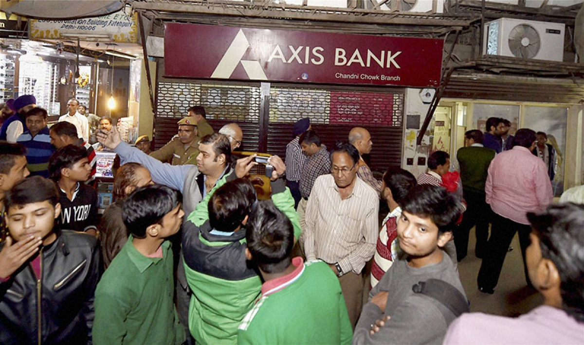 Axis bank branch under  I-T lens for suspect a/cs