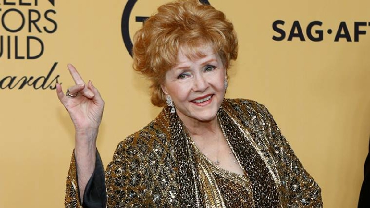 Debbie Reynolds dies at 84, a day after the death of daughter Carrie Fisher