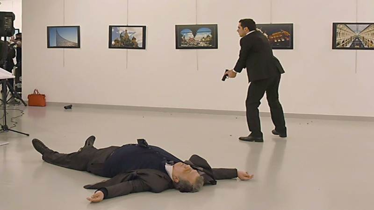 Turkey detains six over envoy murder as Russia seeks answers