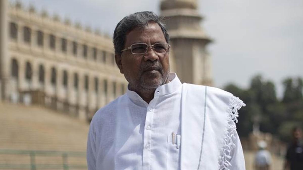 Karnataka Govt waives farmer loans upto Rs. 50,000