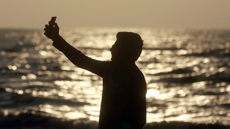 In this Feb. 22, 2016, photo, an Indian man takes a selfie in Mumbai's coastline. India is home to the highest number of people who have died while taking photos of themselves, with 19 of the world's 49 recorded selfie-linked deaths since 2014, according to San Francisco-based data service provider Priceonomics. The statistic may in part be due to India's sheer size, with 1.25 billion citizens and one of the world's fastest-growing smartphone markets. (AP Photo/Rafiq Maqbool)