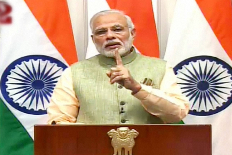 New Delhi:  Prime Minister Narendra Modi gestures as he addresses the nation on the eve of New Year, in New Delhi on Saturday.   PTI Photo/ TV Grab-Courtesy DD(PTI12_31_2016_000188B)