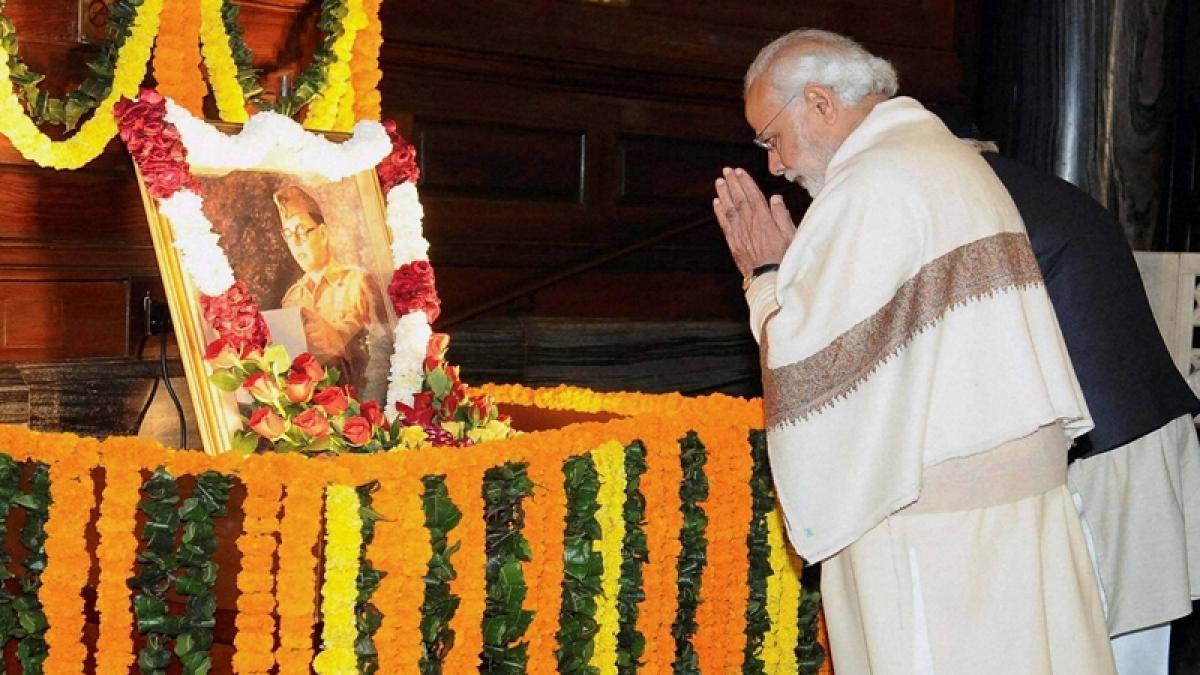 New Delhi: PM Narendra Modi pays homage to Netaji Subhas Chandra Bose on his birth anniversary at Parliament House, in New Delhi on Monday. PTI Photo/PIB