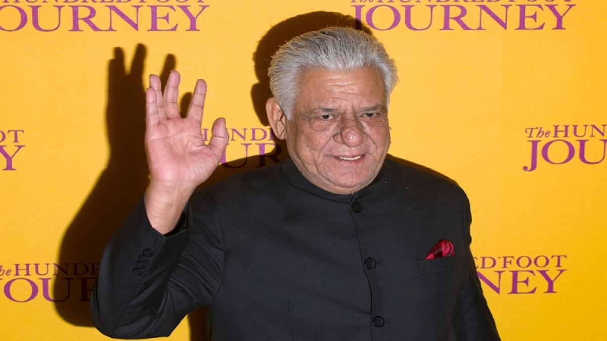 (FILES) This file photograph taken on September 3, 2014, shows Indian Bollywood actor Om Puri waving as he attends the UK Gala Screening of the film, The Hundred Foot Journey, in central London.  Acclaimed Indian actor Om Puri, well-known abroad for his role in hit movie Gandhi, has died aged 66 after suffering a heart attack on January 6, 2016, reports said. / AFP PHOTO / JUSTIN TALLIS