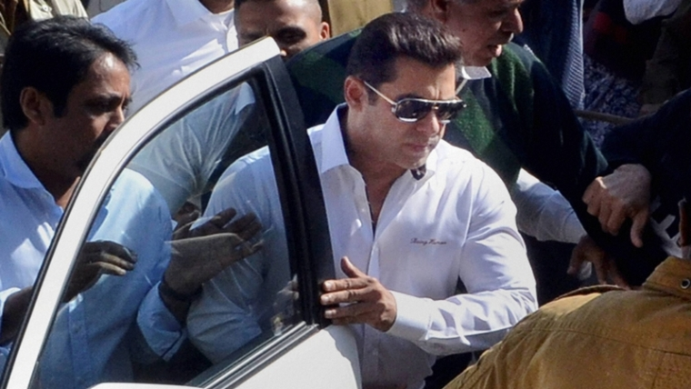 Jodhpur: Bollywood actor Salman Khan, walks through a crowd outside the court, has been acquitted in 1998 Arms Act case by Jodhpur court, in Jodhpur on Wednesday. PTI Photo