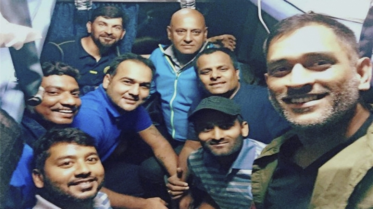 Dhoni travels in train with Jharkhand team after 13 years