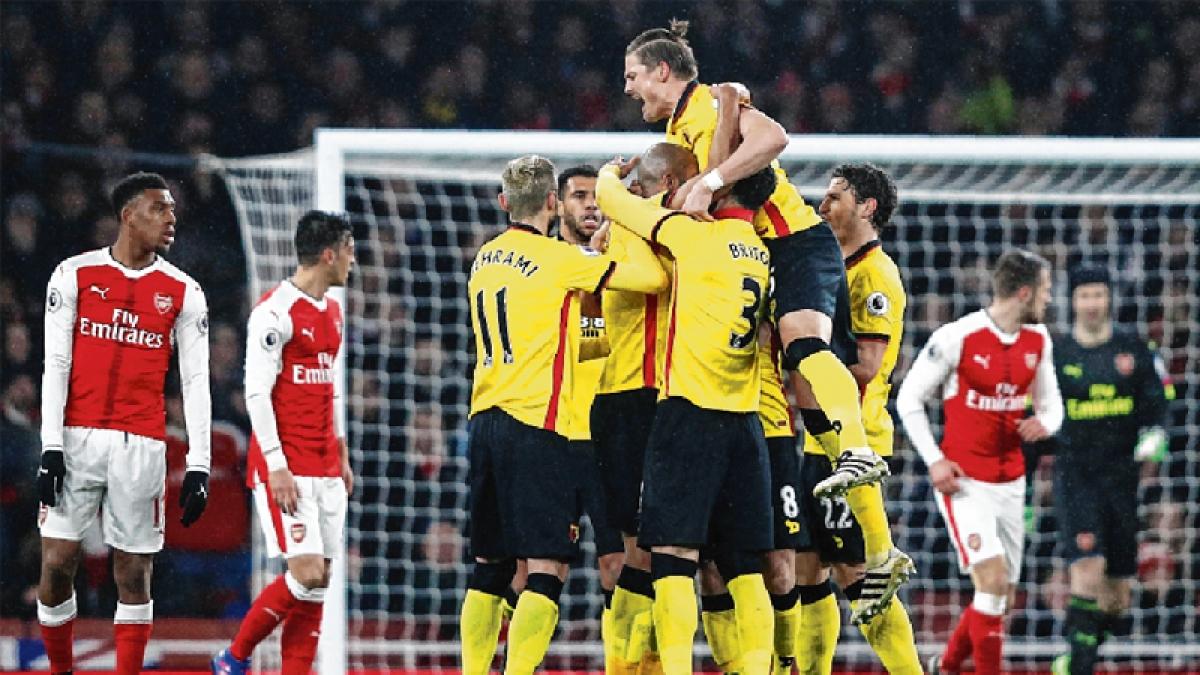 Watford stun Arsenal : Gunners' title challenge torpedoed by shock 1-2 loss