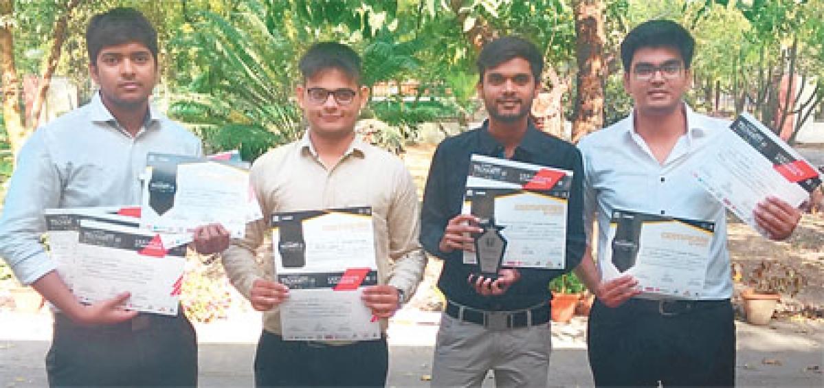 Ishan Sharma, Dikshant Mahant, Divesh Sharma and Avinash Sharma with their winning certificate at IIT Kanpur.