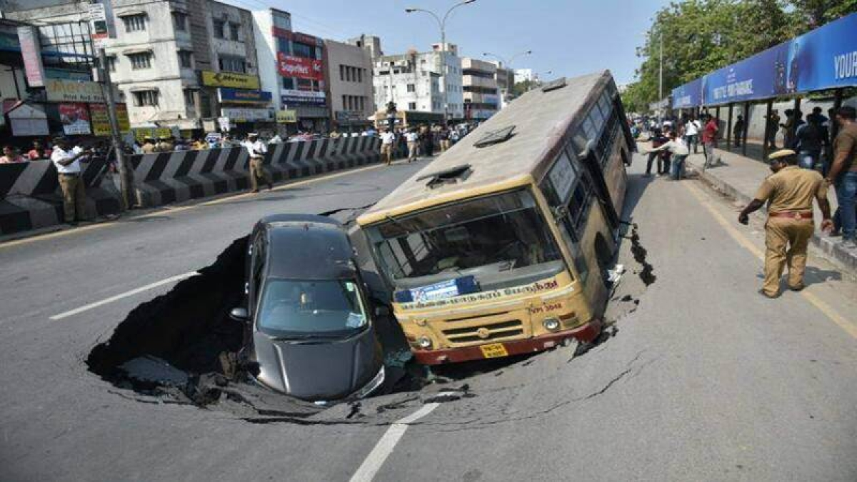 Cave-in on Chennai road takes city bus and car along
