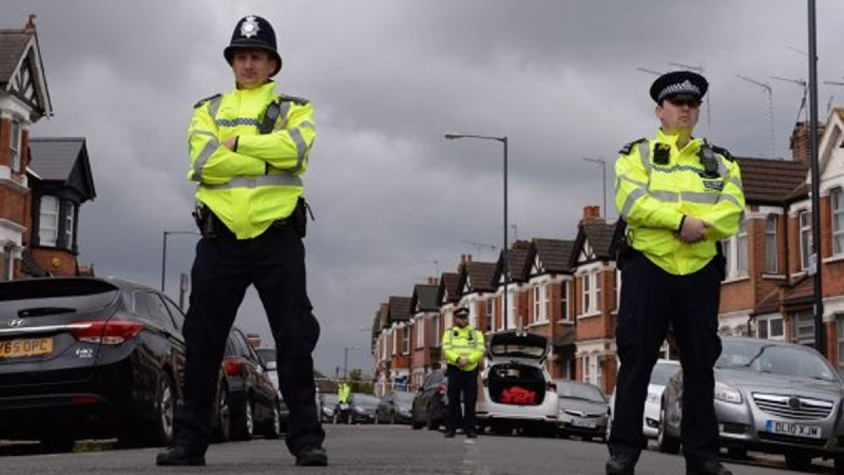 Woman shot, 6 others held in counter-terror operation in London