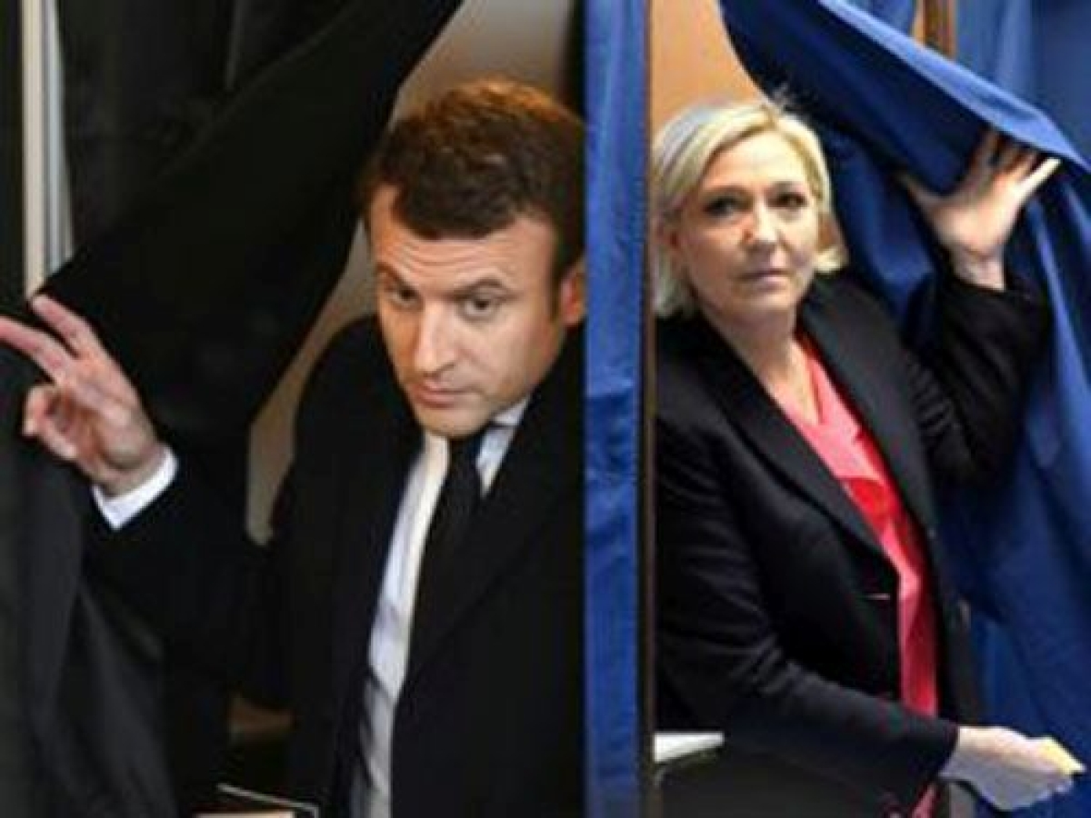 Macron, Le Pen face off as France votes for president