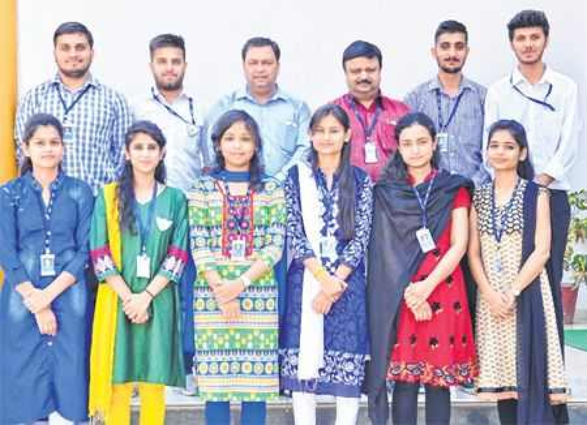 Students of MIT, who have been selected in campus interview, pose along with faculty members. FP PHOTO
