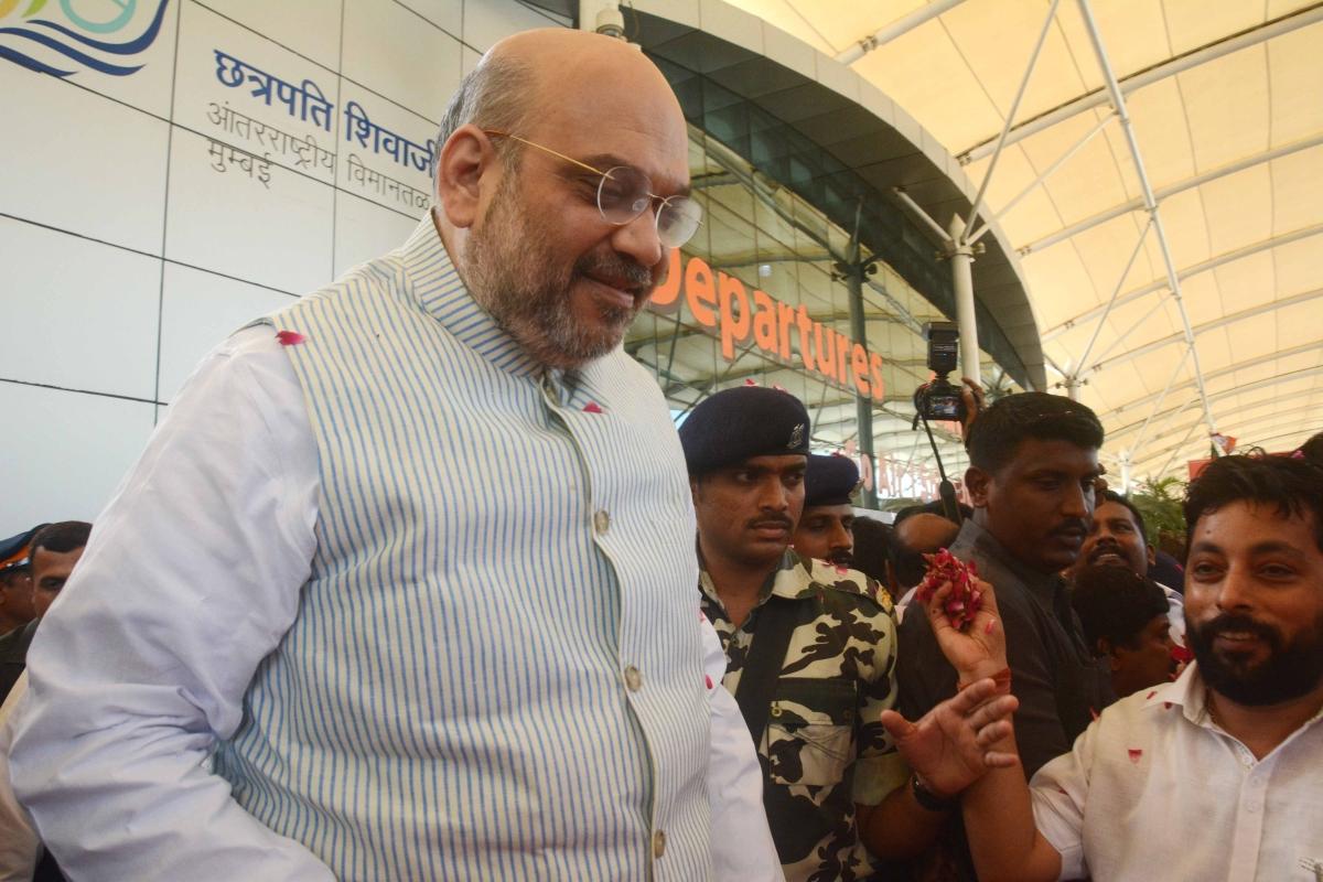 Mumbai: Bharatiya Janata Party (BJP) National President Amit Shah arrival in Mumbai party workers warm Welcome at Domestic airport Mumbai. Photo by BL SONI
