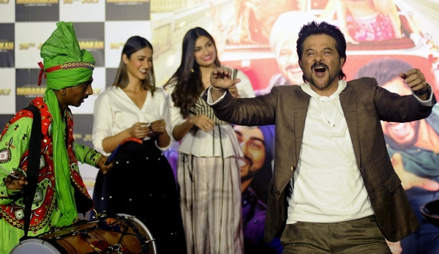 Indian Bollywood actor Anil Kapoor dances onstage during a promotional event for the forthcoming Hindi film 'Mubarakan' directed by Anees Bazmee in Mumbai on June 20, 2017. / AFP PHOTO / STR