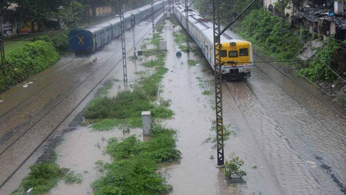 Mumbai: Heavy rains lash city, local train services on Central Railway hit hard