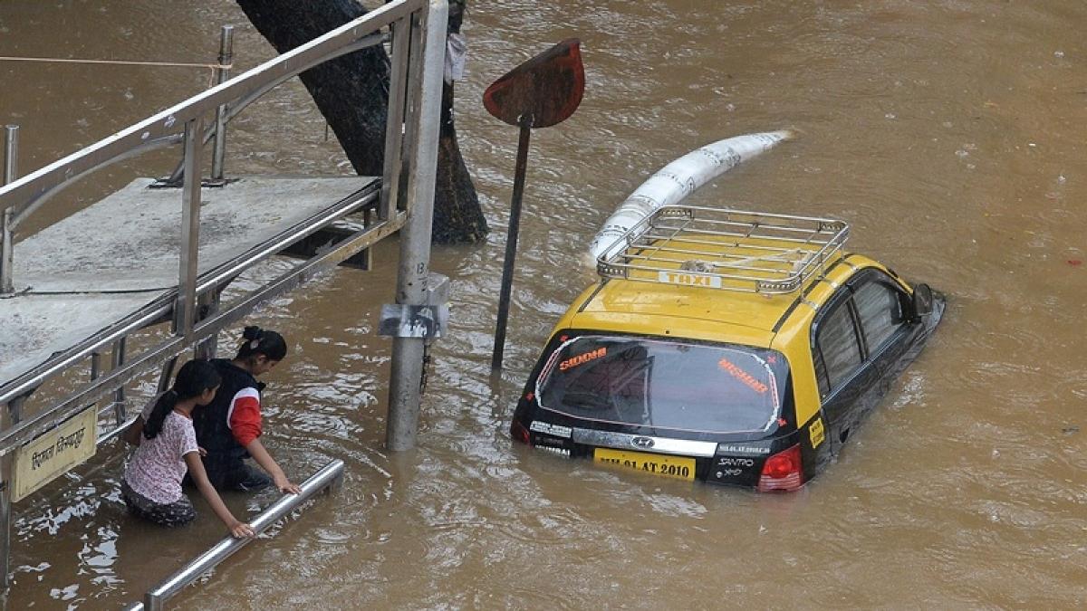 Heavy rain causes water logging, flood situation in Mumbai, Manipur