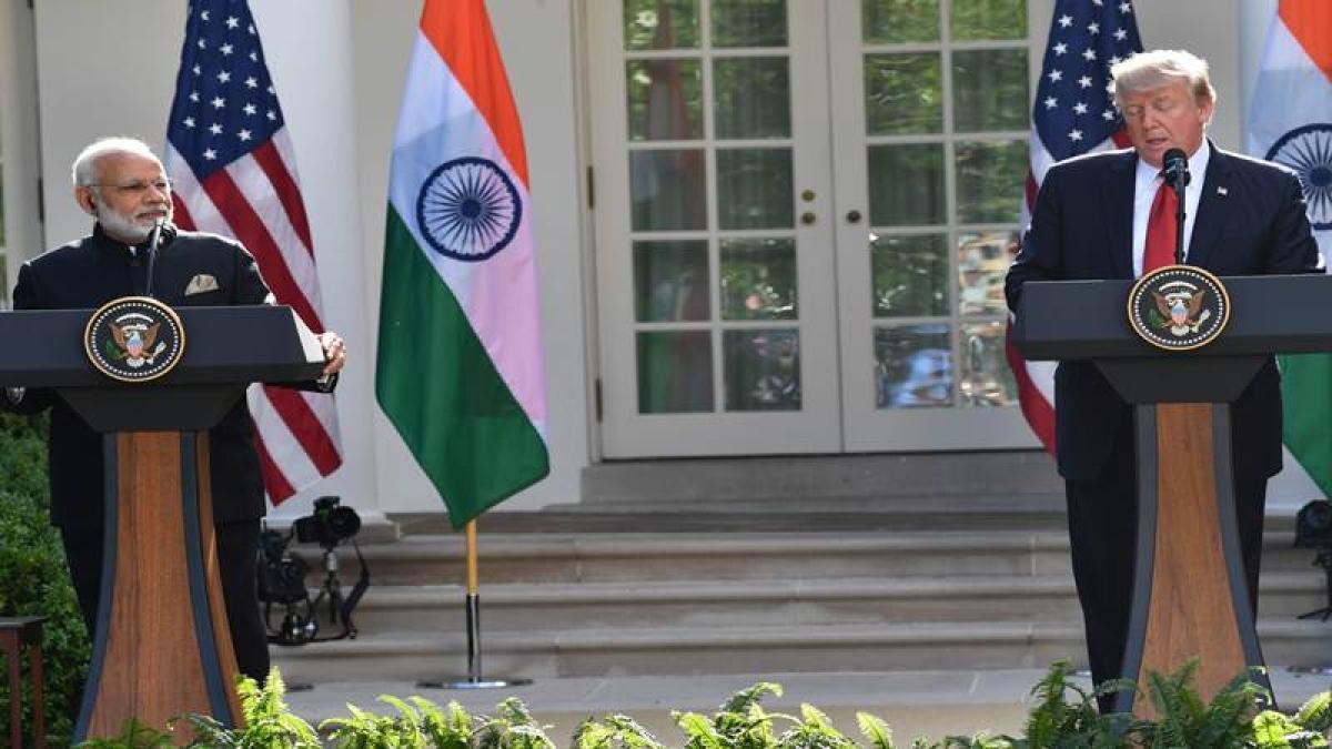 Indian Prime Minister Narendra Modi (L) and (R) US President Donald Trump.