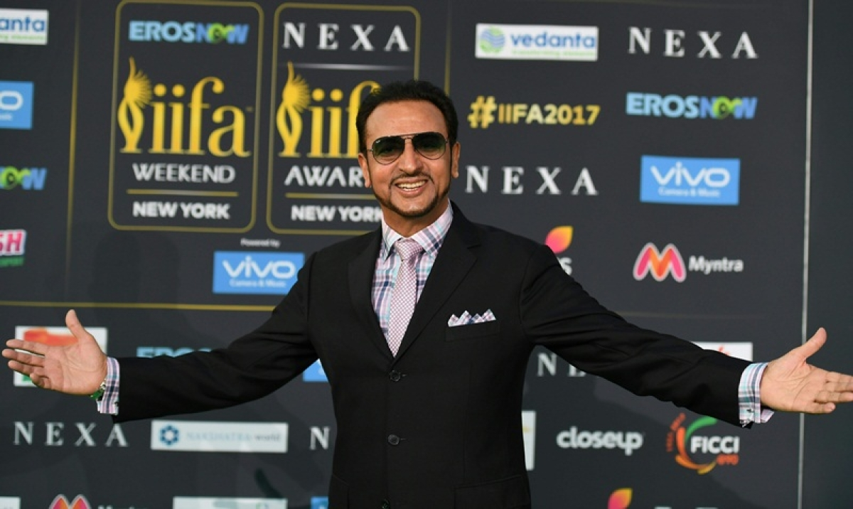 Bollywood actor Gulshan Grover poses as he arrives for the IIFA Awards July 15, 2017 at the MetLife Stadium in East Rutherford, New Jersey during the 18th International Indian Film Academy (IIFA) Festival. / AFP PHOTO / ANGELA WEISS