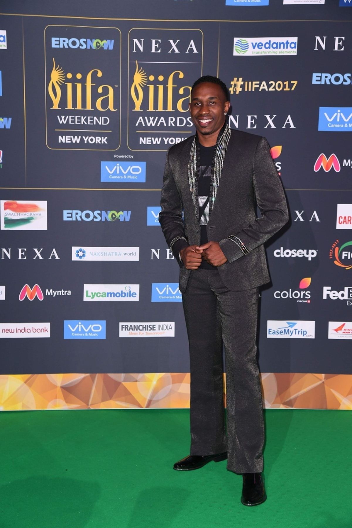 West Indies cricket player Dwayne Bravo arrives for the IIFA Awards July 15, 2017 at the MetLife Stadium in East Rutherford, New Jersey during the 18th International Indian Film Academy (IIFA) Festival. / AFP PHOTO / ANGELA WEISS
