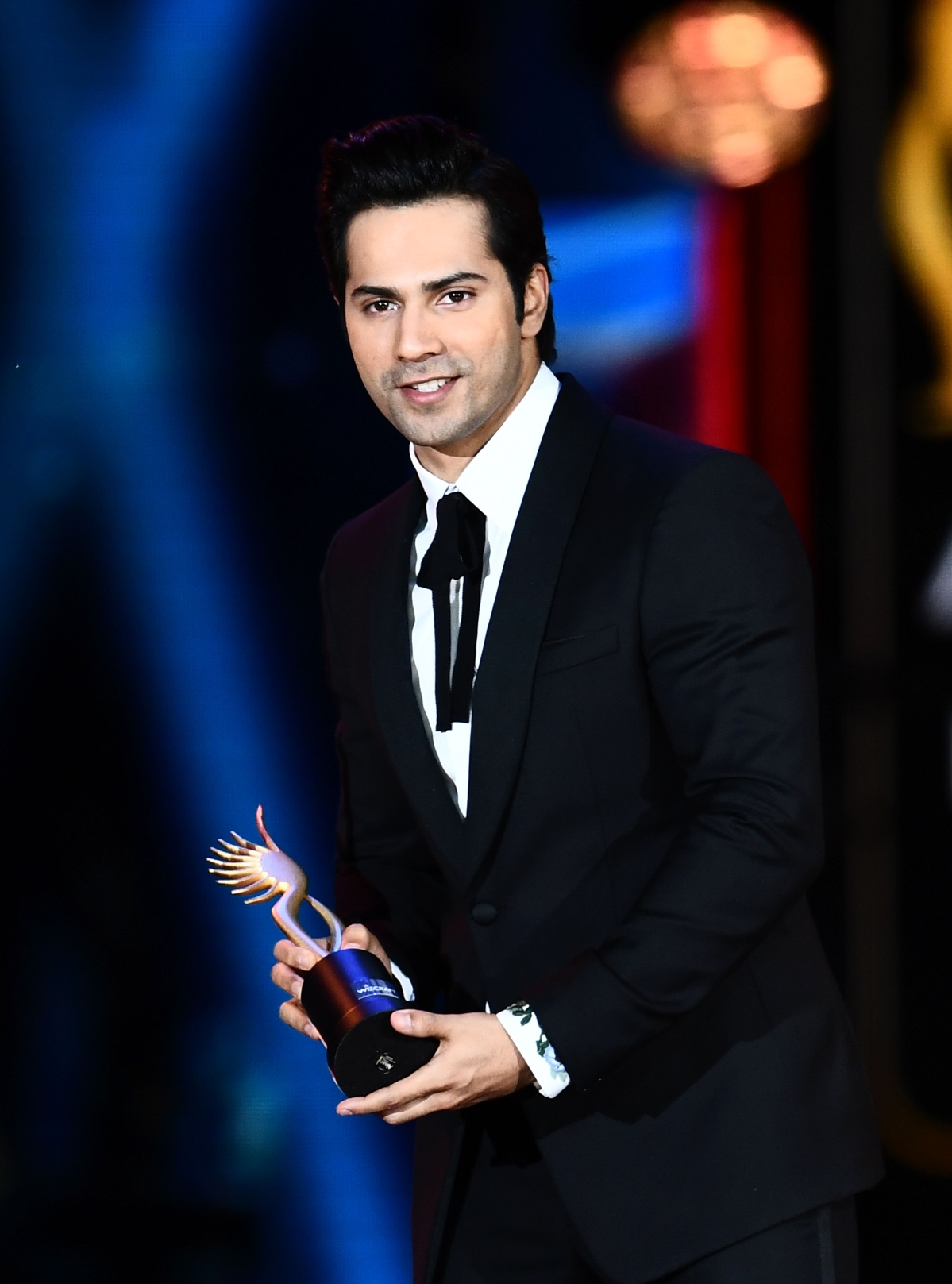 """Winner of Performance in a Comic Role, Varun Dhawan (L) for """"Dishoom"""" accepts the award during the 18th International Indian Film Academy (IIFA) Festival at the MetLife Stadium in East Rutherford, New Jersey, on July 15, 2017. / AFP PHOTO / JEWEL SAMAD"""