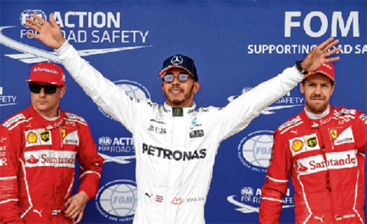 Hamilton storms to British GP pole