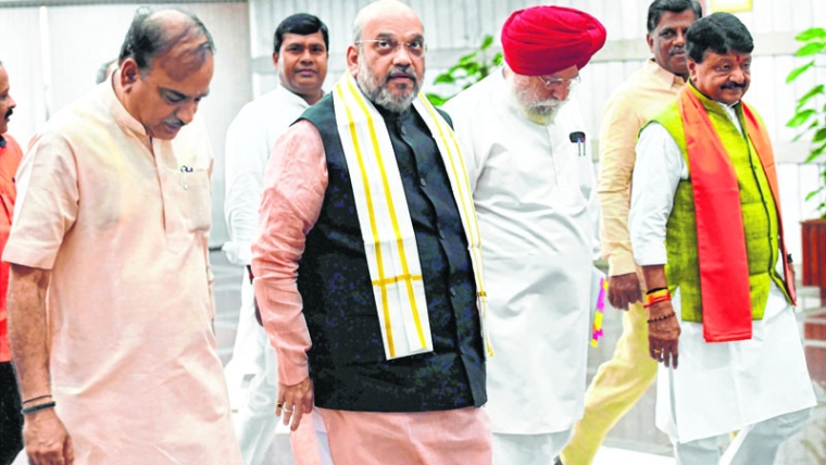 New Delhi: BJP President Amit Shah, Parliamentary Affairs Minister Ananth Kumar (L), and MoS SS Ahluwalia (R) arrive to attend BJP parliamentary party meeting, in New Delhi on Tuesday. PTI Photo by Shahbaz Khan  (PTI8_1_2017_000051B)
