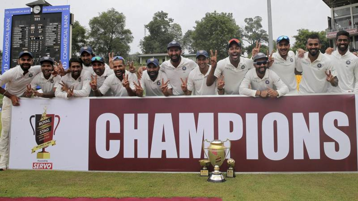 Indian cricket team pose with the winners trophy after their win over Sri Lanka in the third cricket test match in Pallekele, Sri Lanka. AP/PTI