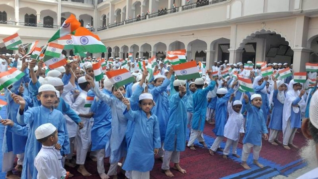 Moradabad: Muslim children hold the tricolour flag during the 71st Independence Day celebrations at a madrasa in Moradabad on Tuesday. PTI Photo<br />(PTI8_15_2017_000134B)
