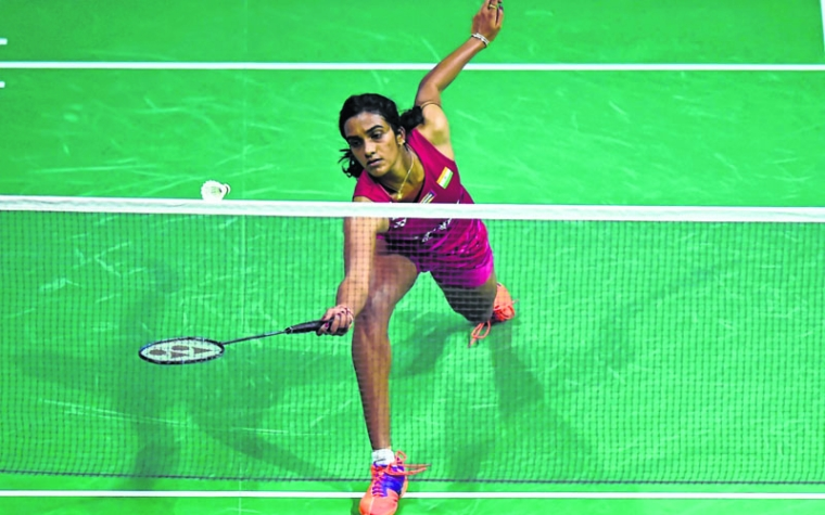 India's Sindhu Pusarla prepares returns against China's Sun Yu during their Quarter final women's singles match during the 2017 BWF World Championships of badminton at Emirates Arena in Glasgow on August 25, 2017. / AFP PHOTO / ANDY BUCHANAN