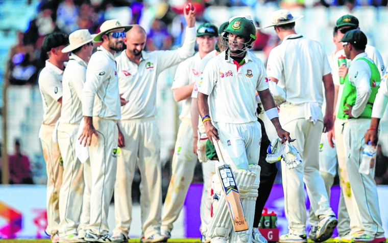 Chittagong : Bangladesh's Sabbir Rahman, foreground, walks back to the pavilion after his dismissal by Australia's Nathan Lyon, fourth left, during the first day of their second test cricket match in Chittagong, Bangladesh, Monday, Sept. 4, 2017. AP/PTI(AP9_4_2017_000137B)
