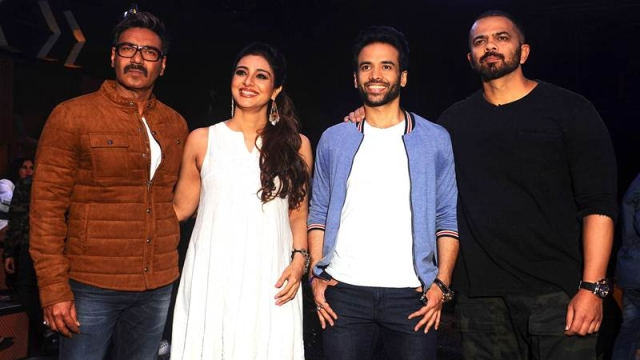Indian Bollywood actors Ajay Devgn (L), Tabbu (2L) and Tusshar Kapoor (2R) and director Rohit Shetty pose for a photograph during a promotional event for the 'Khatron Ke Khiladi' reality show, based on the US format 'Fear Factor' in Mumbai on late September 19, 2017. / AFP PHOTO / STR