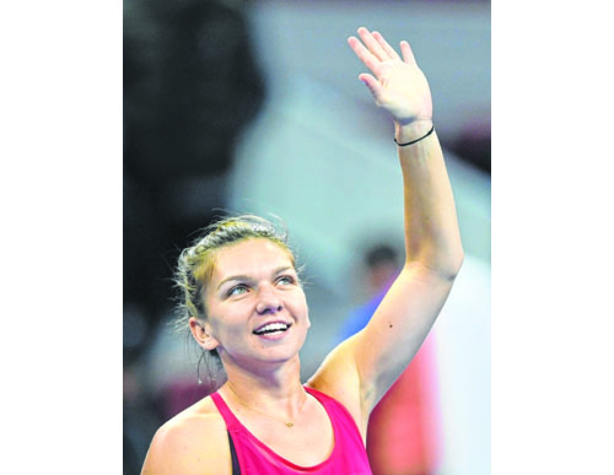 Simona Halep notches first career win over Sharapova