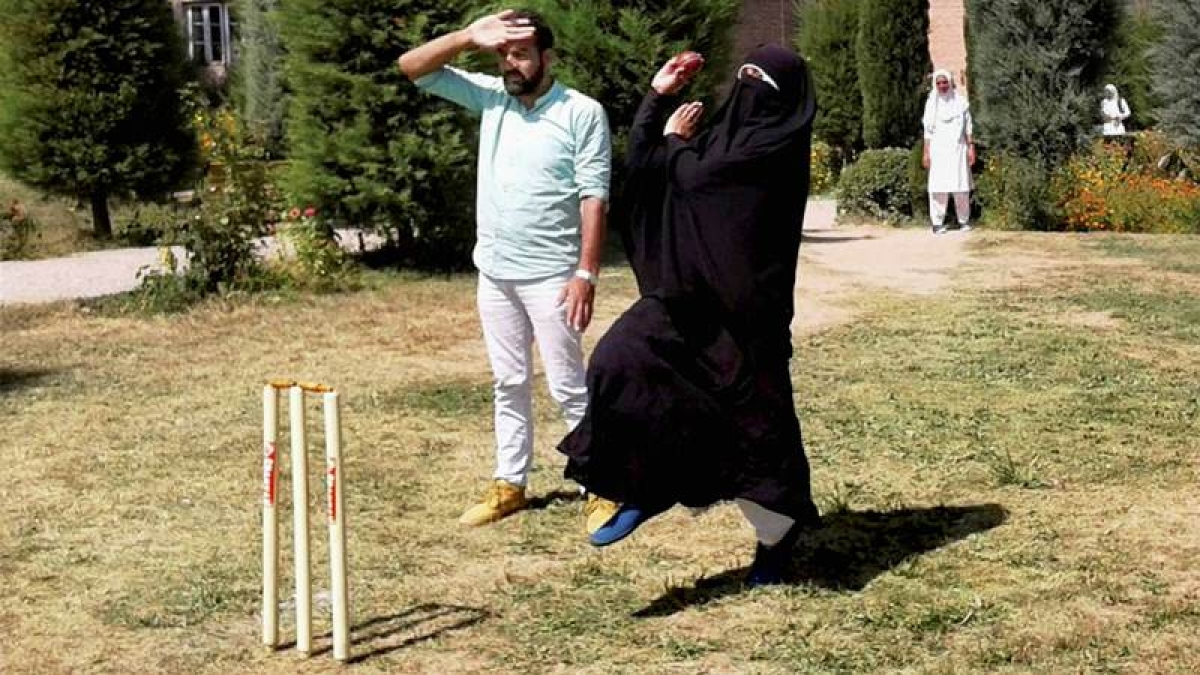 Cricket in burqa. A woman cricketer in Baramulla defying social restrictions in her passion for the sport. PTI Photo (STOTRY DEL18)