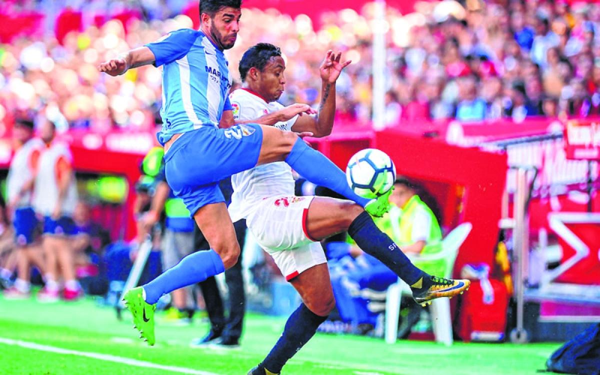 Sevilla move second as Atletico held in Leganes