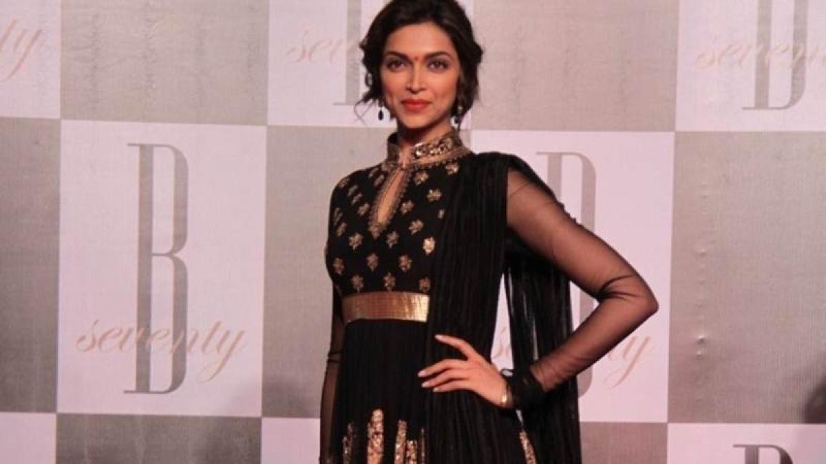 Deepika Padukone's look is a perfect example of embellished yet elegant.