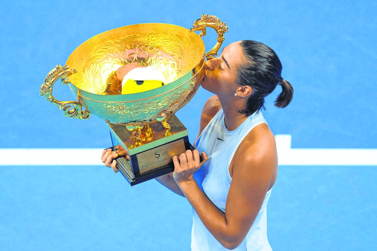 Garcia stuns Halep for first premier title in Beijing