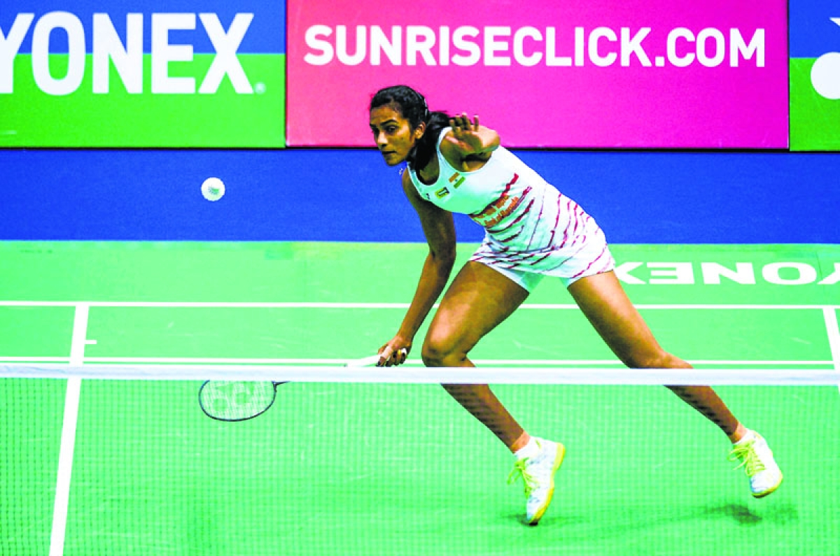India's Pusarla V. Sindhu hits a return against Thailand's Ratchanok Intanon during their women's singles semi-final match at the Hong Kong Open badminton tournament in Hong Kong on November 25, 2017. / AFP PHOTO / ISAAC LAWRENCE