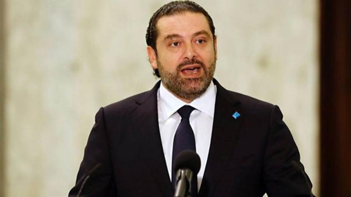 Saad Hariri says resignation on hold, pledges to stay in Lebanon