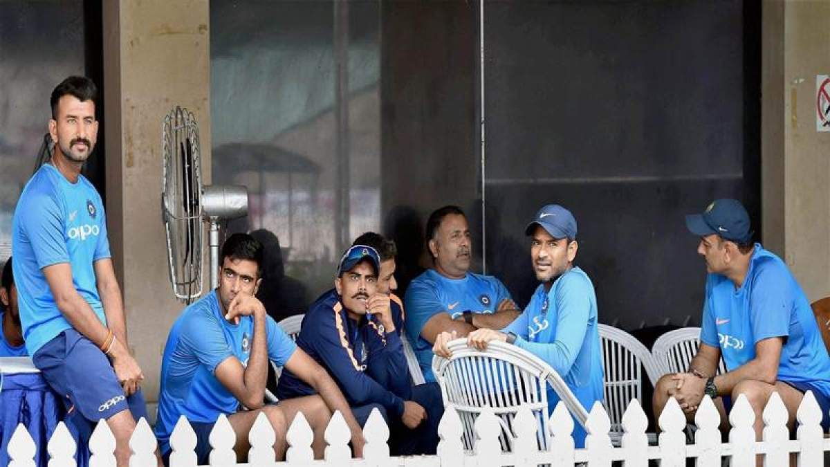 Kolkata: Indian cricket team coach Ravi Shastri and players sitting in the pavilion as rains delay the start of first day's play of the 1st cricket test match between India and Sri Lanka, in Kolkata on Thursday. PTI Photo by Ashok Bhaumik    (PTI11_16_2017_000027B)
