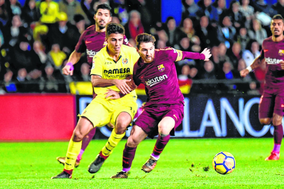 Barca marches on in Spain